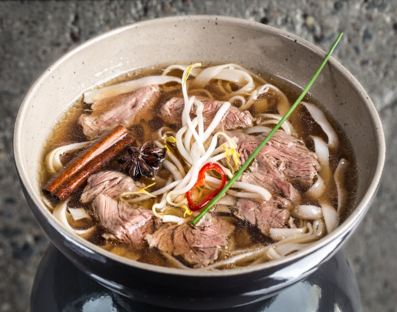 Asian soup with beef and rice noodles ( Pho Bo)