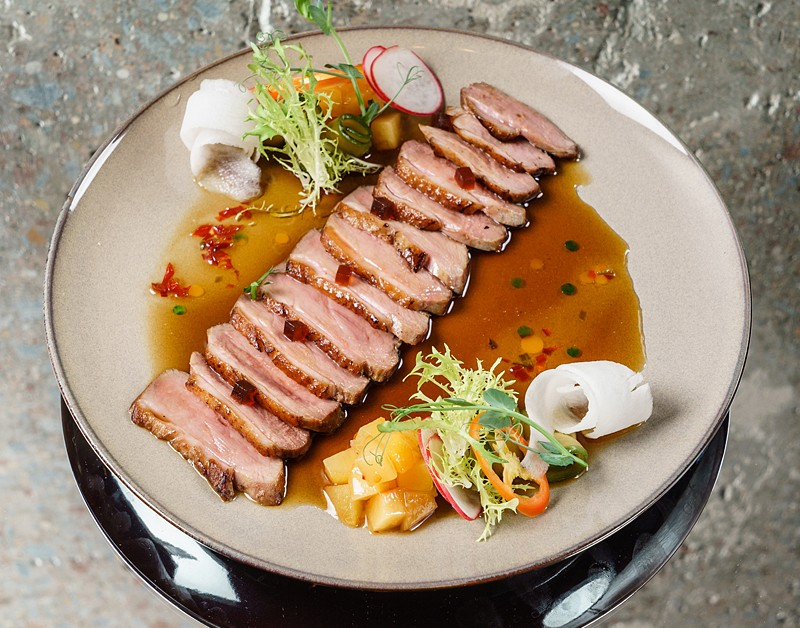 Duck sashimi with ponzu sauce and smoked plum