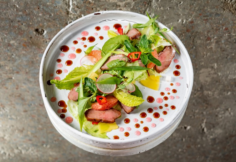 Salad with duck breast, coconut marmalade